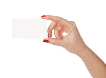 Female hand holding a blank paper. isolated in white photo