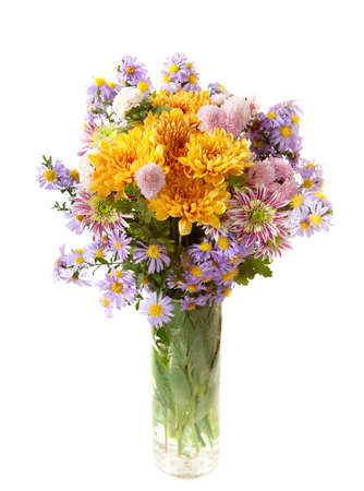 colourful chrysanthemums bunch  in transparent vase isolated on a white background photo