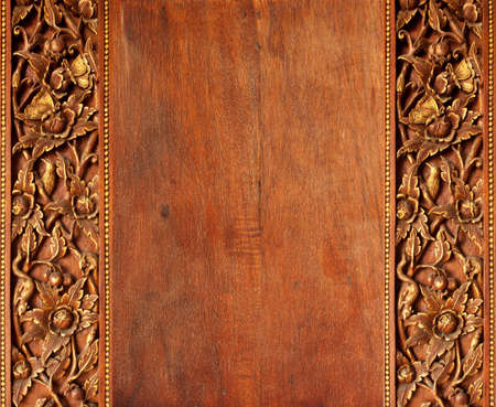 wood carving 3d: Old worn  wooden board with oriental ornament