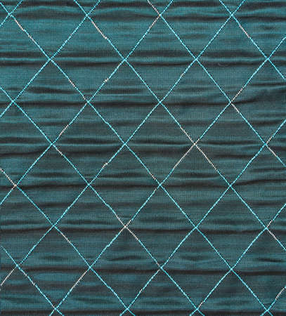 quilted: dark aquamarine  quilted satin background. Stock Photo