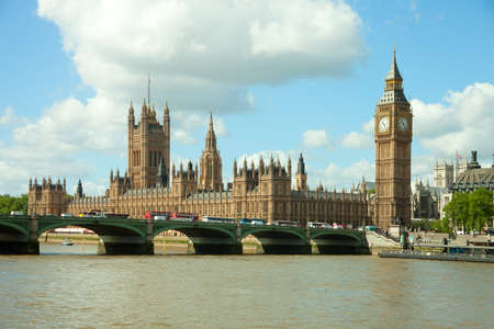 city of westminster: House of Parliament with Big Ban tower in London UK view from Themes river