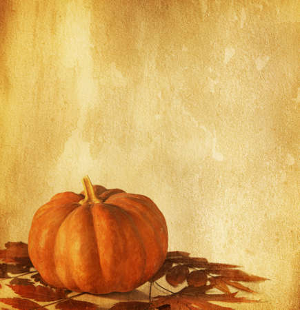 old paper with pumpkin and dry autumn leaves photo