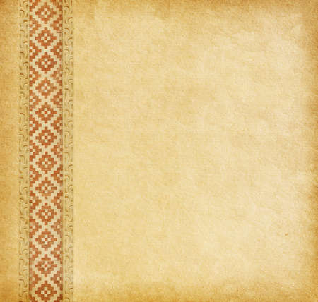 Beige background. Old worn paper with oriental ornament. photo