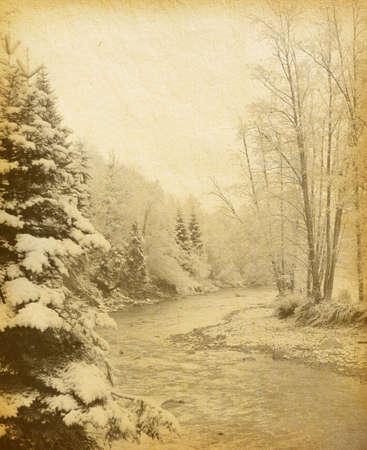 vintage paper . winter landscape in the carpathians mountains . sepia photo