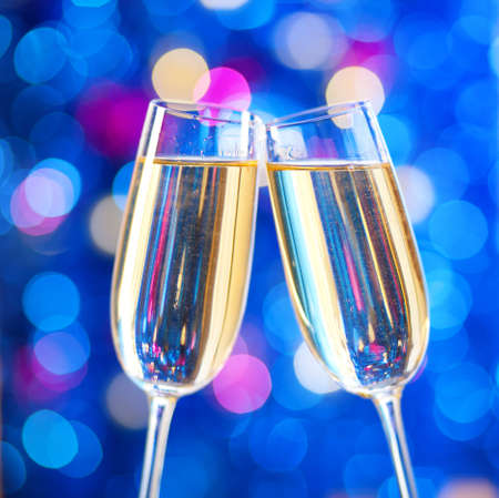 Two glasses of champagne with lights in the background. very shallow depth of field. Stock Photo - 16406150