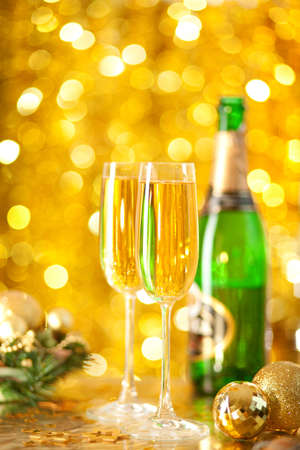 Two glasses of champagne with a Christmas decor in the background photo