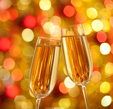 Two glasses of champagne with lights in the background. very shallow depth of field. photo