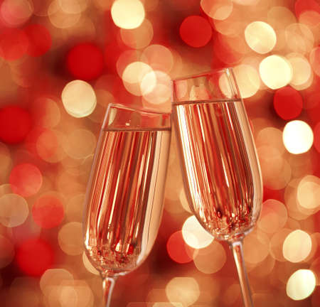 Two glasses of champagne with lights in the background. very shallow depth of field. Stock Photo - 17603202