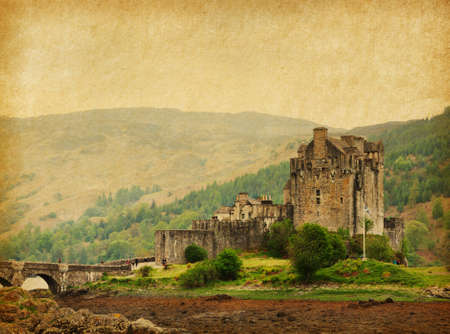 loch: Eilean Donan castle on a cloudy day  low tide  Scotland, UK  Photo in retro style  Paper texture