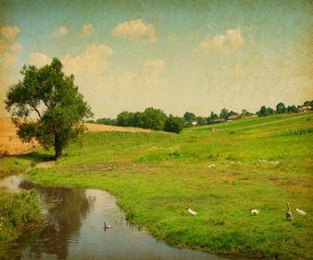 Retro image of rural landscape with  pond  Paper texture photo