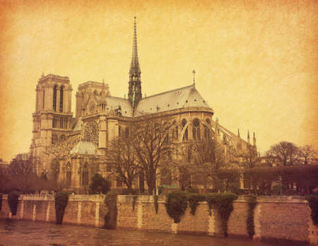 Notre Dame Paris. View from the south in retro style. Paper texture. photo