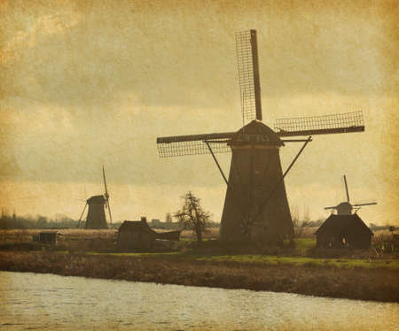 wind mills: Mill Network at Kinderdijk-Elshout, Netherlands.  Photo in retro style. Paper texture.