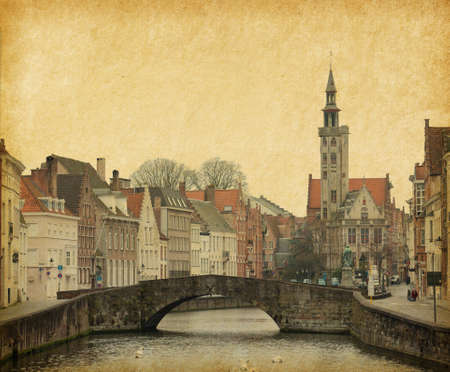 One of the numerous bridges in Brugge, Belgium  Photo in retro style  Paper texture  photo