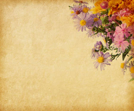 Beige paper  with autumn flowers photo