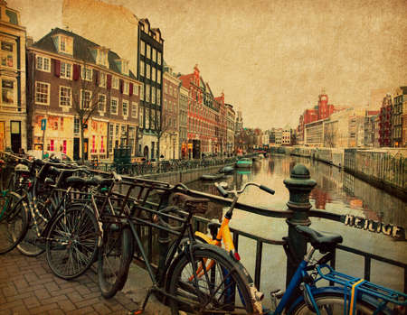 Amsterdam  The Singel is one of the numerous canals in Amsterdam, Netherlands Photo in retro style  Paper texture  photo