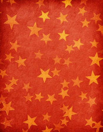 vintage red paper decorated with  gold stars