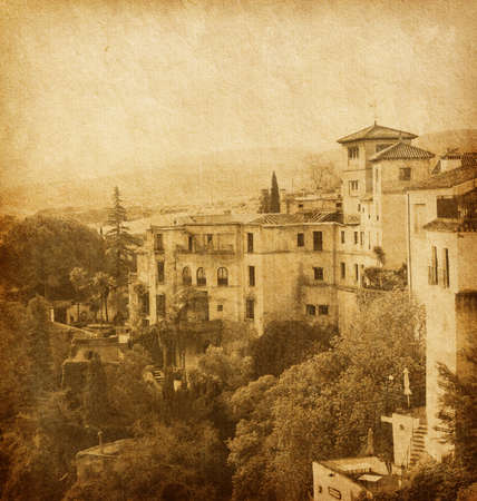 ancient architecture of Ronda, Andalusia,  Spain      Photo in retro style  Added paper texture  photo