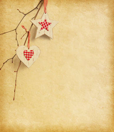 Christmas decoration hanging over old paper background  photo