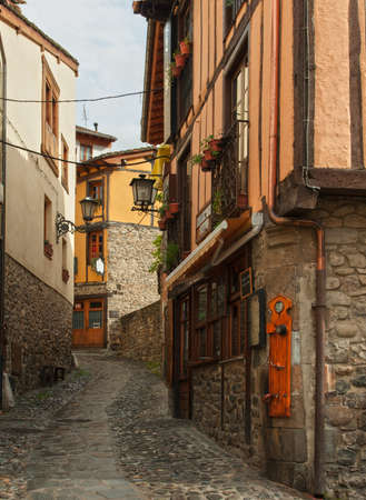 The narrow street with old houses in Potes, Cantabria, Spain  photo