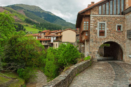 Old street in Potes, Cantabria,  Spain photo