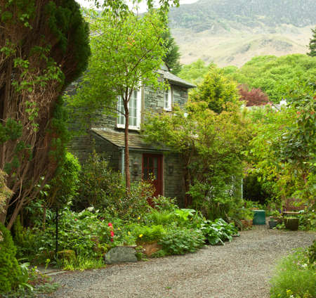 garden at the front of old house, Lake District, Cumbria, UK   photo