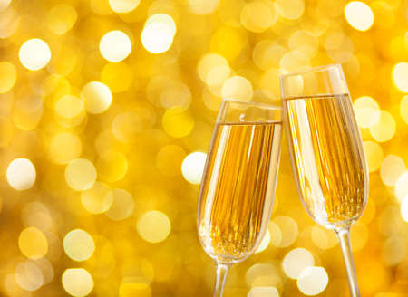 two years: Two glasses of champagne with lights in the background  very shallow depth of field  Stock Photo
