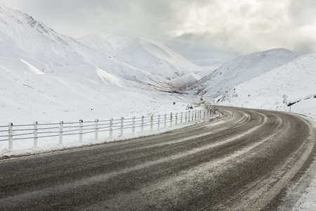 Empty mountain road on a cloudy winter day. South Island, New Zealand photo
