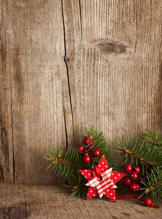 Christmas decoration on wooden plank Imagens - 23833902