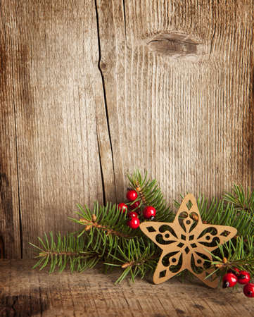 Christmas decoration on wooden plank Imagens - 23833892