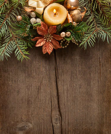 Christmas border on  on wooden plank  photo