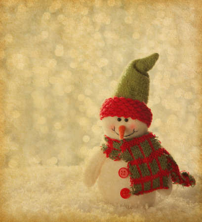 retro image with happy snowman  old paper photo