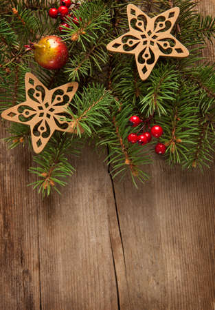 Christmas border on   wooden plank  photo
