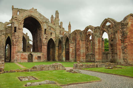 lavishly: Melrose Abbey,  Scottish Borders, UK  Melrose Abbey is a magnificent ruin on a grand scale with lavishly decorated masonry