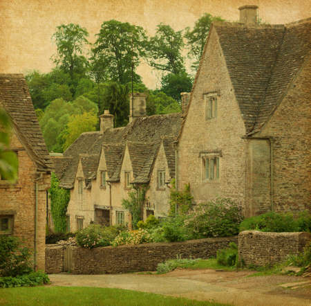 Bibury in spring  Traditional Cotswold cottages in England, UK  Photo in retro style  Paper texture  photo