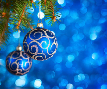 Christmas Baubles on light blue background with sparkles . photo
