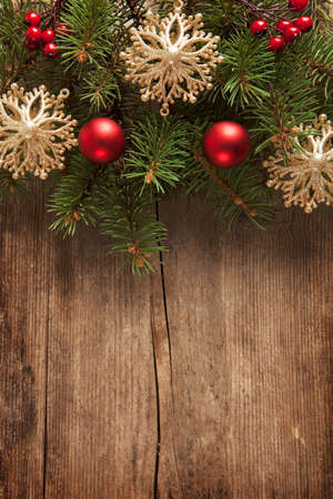 Old grunge wooden board with Christmas border. photo