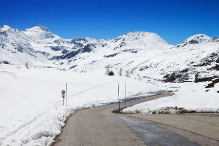 Mountain road in a sunny day (Swiss alps). Simplon Pass, Valais, Switzerland photo