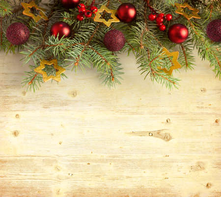 Christmas decoration on old grunge wooden board photo