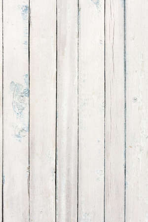 painted wood: Old wooden board painted white.