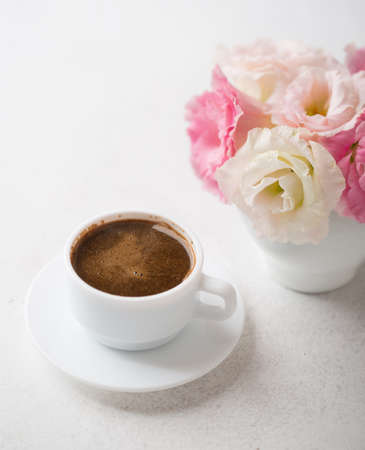 coffeetime: Still life with  cup of coffee  and flowers Eustoma. Shallow depth of field.