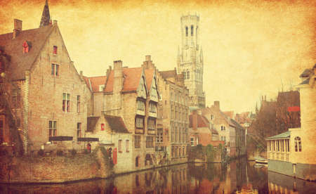 paper old: Bruges historic centre. The classic view from the Rozenhoedkaai, Belgium.  Photo in retro style. Added paper texture