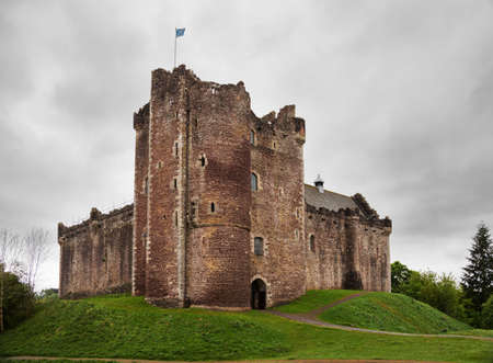 Doune Castle  on a cloudy spring day. Doune Castle is a medieval stronghold near the village of Doune, in the Stirling district, central Scotland, UK