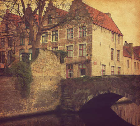 art vintage: A piece of old architecture in  Bruges, Belgium. Photo in retro style. Added paper texture. Toned image Stock Photo