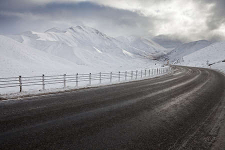 guardrails: Empty mountain road on a cloudy winter day. South Island, New Zealand
