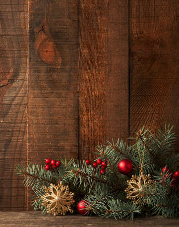snowflake border: Fir branch with Christmas decoration on old wooden plank. Focus  on   Christmas decorations and fir branch Stock Photo