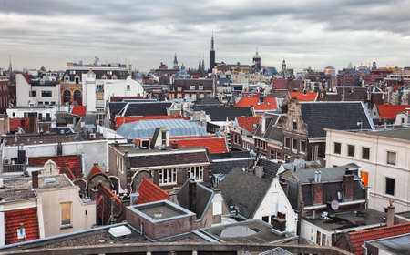 netherlands: Roofs of Amsterdam,  Netherlands. Top view of old-time houses in Amsterdam, Netherlands. Toned image