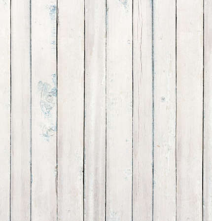 weathered: Old wooden board painted white.