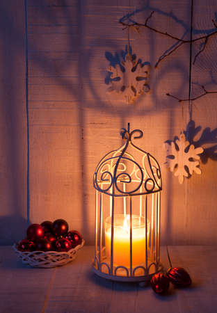 wick: Christmas decorations and lantern at the evening . Focus on the wick candle