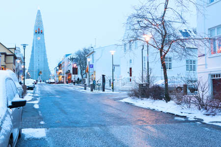 country life: Old street of  downtown Reykjavik, Iceland.  In the background church of Hallgrimur Stock Photo