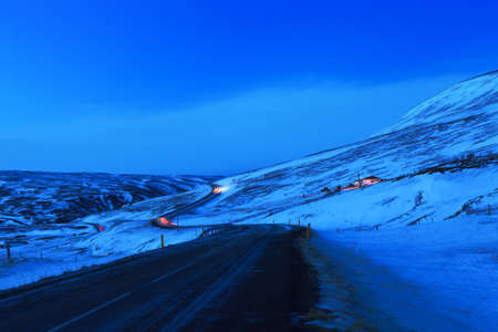 illuminated: Winding road at dusk in winter, Northeast of Iceland. The Ring Road (Route 1) of Iceland, near  Egilsstadir.